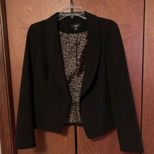 Black blazer with cheetah print inside